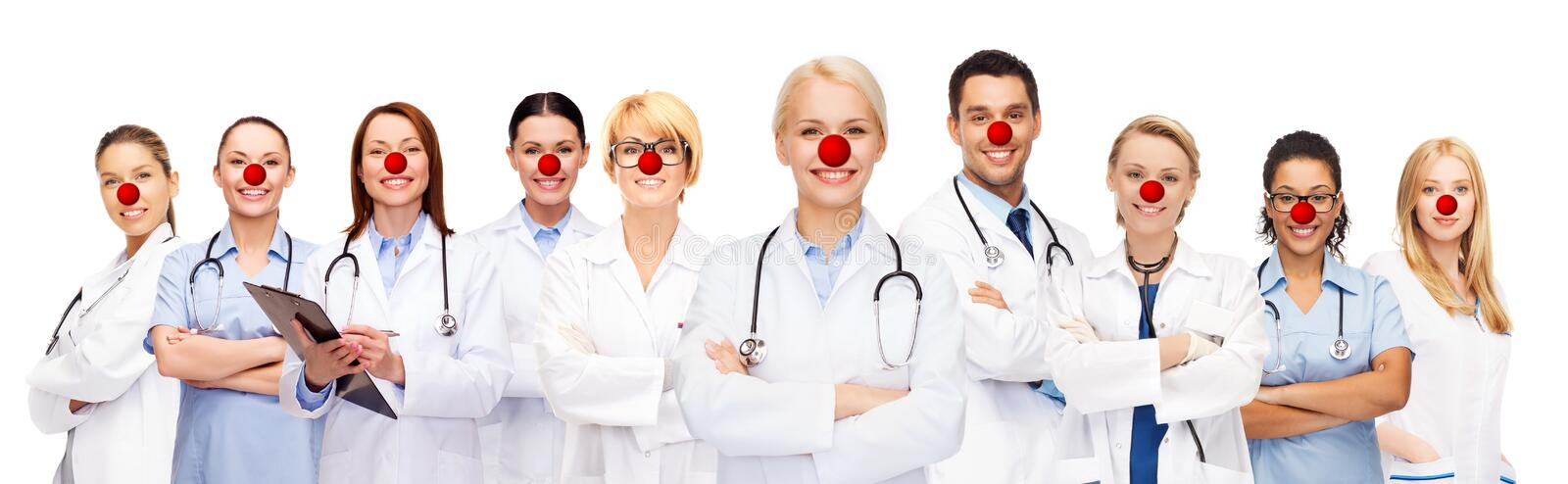 Group of smiling doctors at red nose day royalty free stock photography