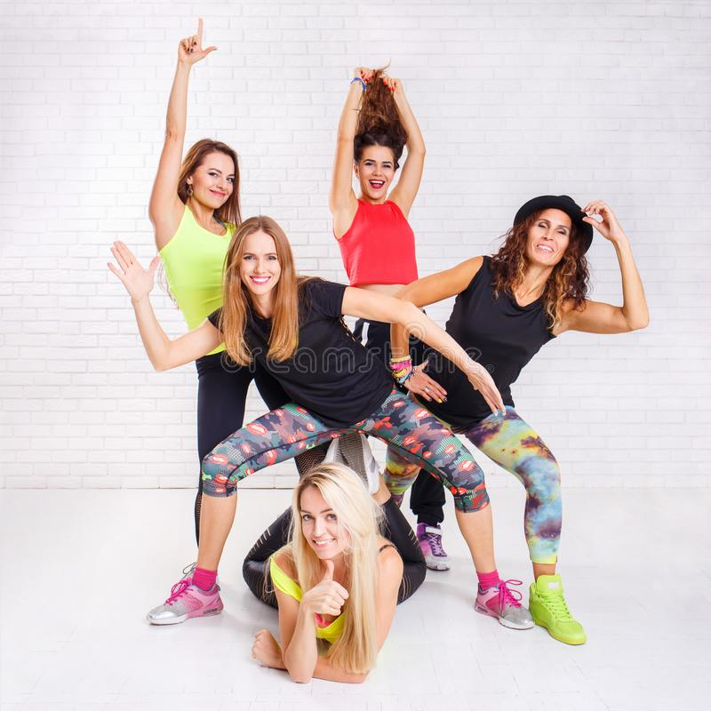 Group of smiling fitness girls having fun together stock images