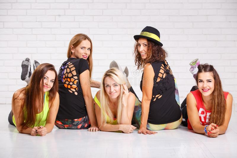 Group of smiling fitness girls having fun together royalty free stock images