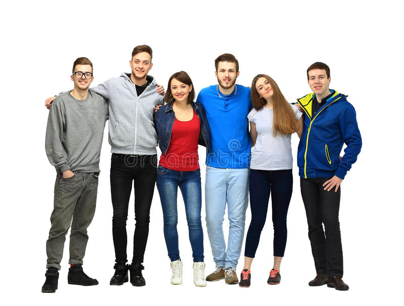 Group of smiling friends staying together. And looking at camera isolated on white background stock image