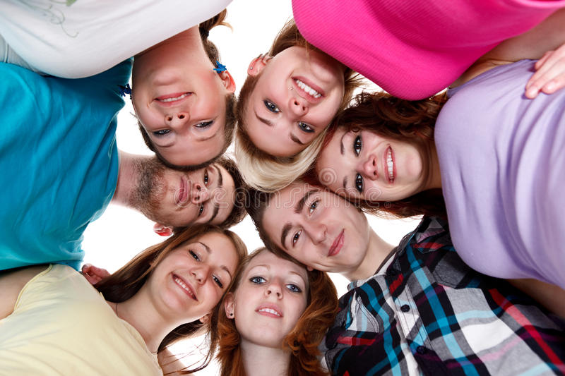 Group of smiling friends with their heads together royalty free stock photos