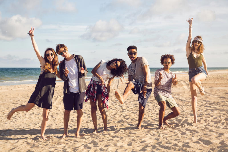 Group of smiling friends wearing summer clothes royalty free stock photo