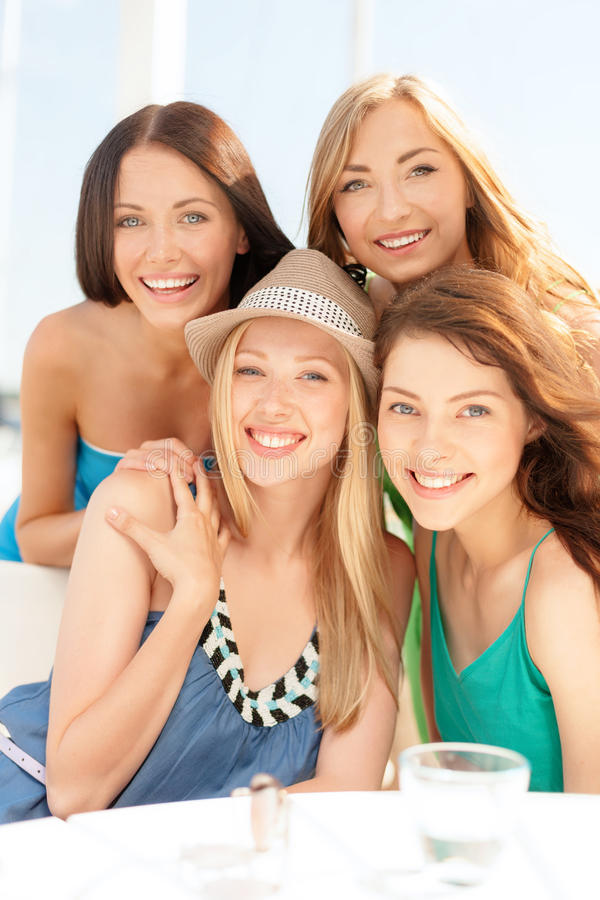 Download Group Of Smiling Girls In Cafe On The Beach Stock Photo - Image: 36732874