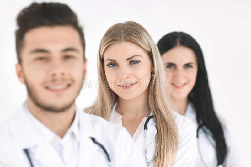 Group of smiling hospital colleagues standing together royalty free stock image