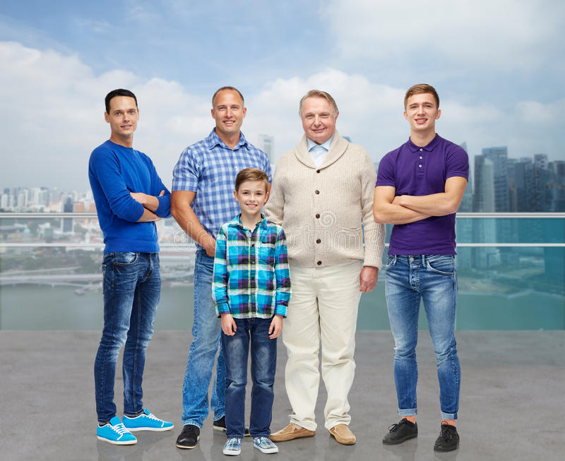 Group of smiling men and boy stock image
