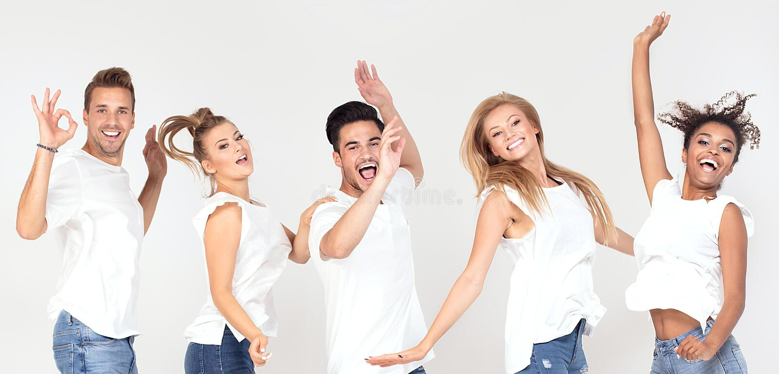 Group of smiling people jumping,having fun together. royalty free stock images