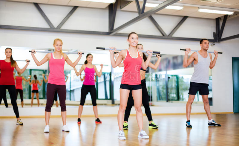 Download Group Of Smiling People Working Out With Barbells Stock Image - Image: 35402519
