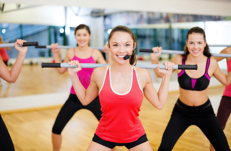 Download Group Of Smiling People Working Out With Barbells Stock Photo - Image: 35507080