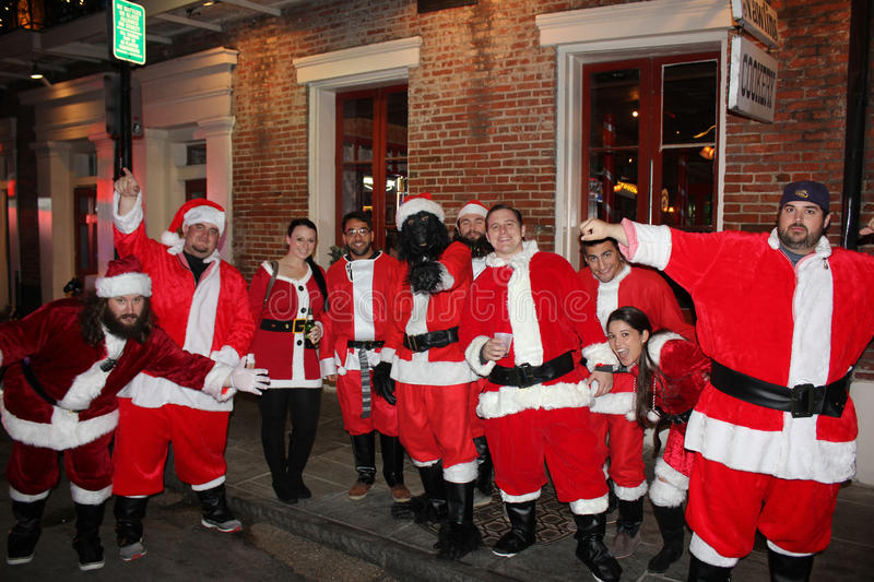 Group smiling Santas party New Orleans stock images