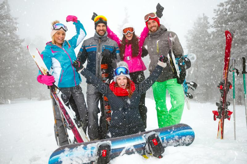 Group of smiling snowboarders having fun royalty free stock photography