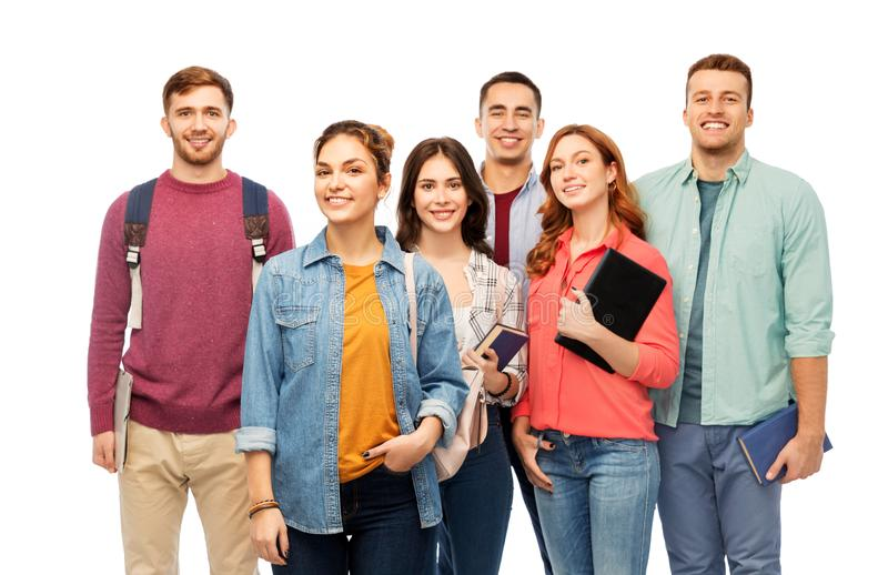 Group of smiling students with books royalty free stock image