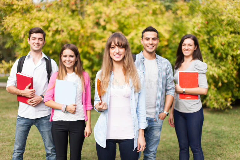 Group of smiling students stock photos