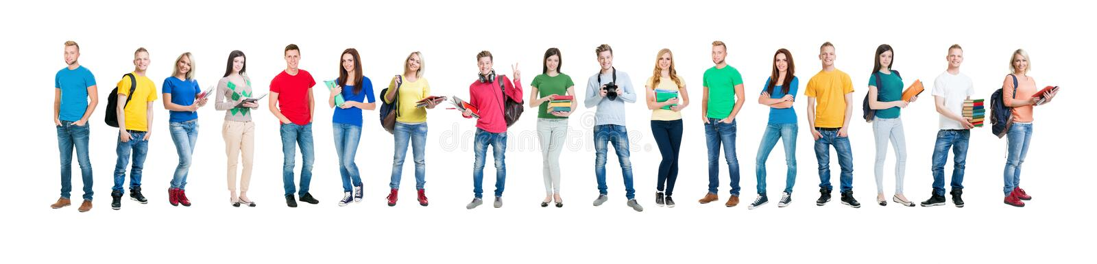 Group of smiling teenagers staying together. And looking at camera isolated on white stock photos