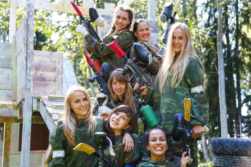 Group of smiling young girls with paintball ammunition stock images
