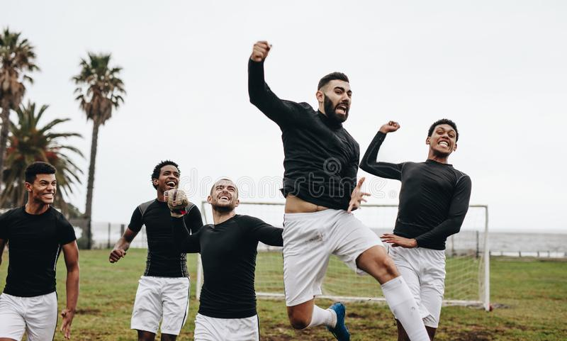 Group of soccer players celebrating victory royalty free stock photography