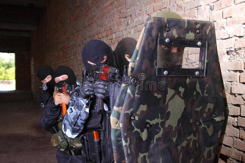 Group of soldier moving behind tactical shield royalty free stock image