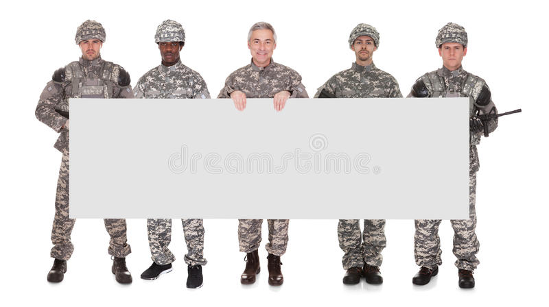Group Of Soldier With Placard royalty free stock images