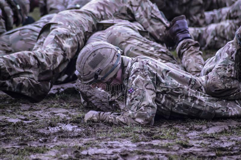 Group of Soldiers Crawling on Mud royalty free stock photography