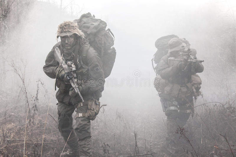 Group of soldiers in the smoke royalty free stock image