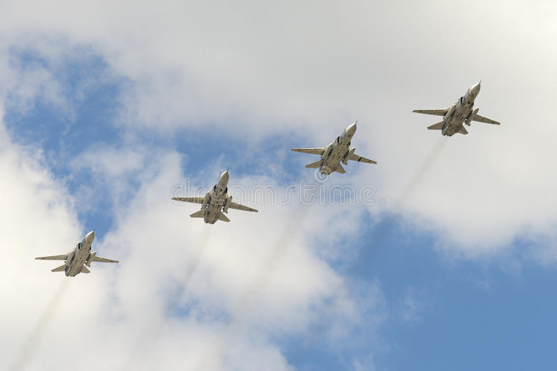 The group of Soviet bomber Sukhoi Su-24 Fencer. MOSCOW, RUSSIA - MAY 07, 2016: The group of Soviet bomber Sukhoi Su-24 Fencer flying over Red Square. Dress royalty free stock photography