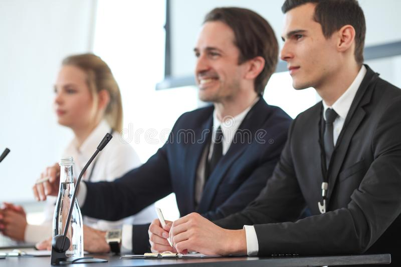 Speakers at business meeting royalty free stock image