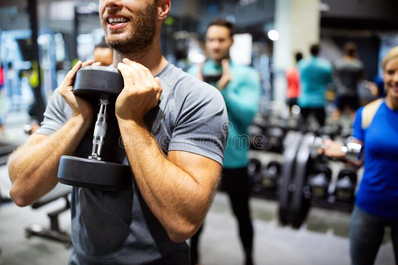 Group of fit people in gym training. Multiracial group of friends working out together royalty free stock photography