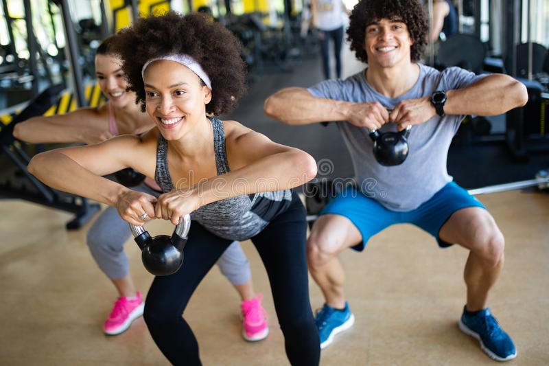 Group of sportive people in a gym training royalty free stock images