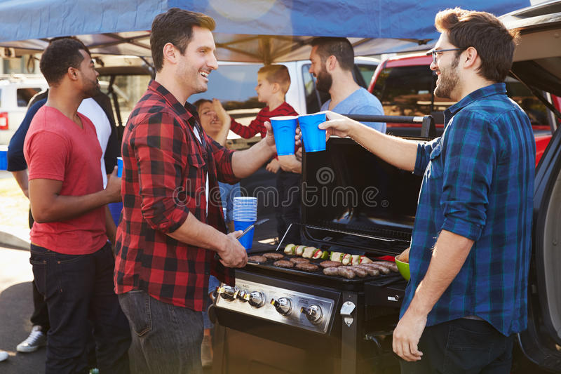 Group Of Sports Fans Tailgating In Stadium Car Park stock photography