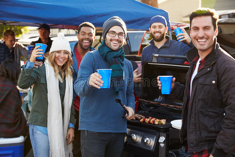 Group Of Sports Fans Tailgating In Stadium Car Park royalty free stock photography