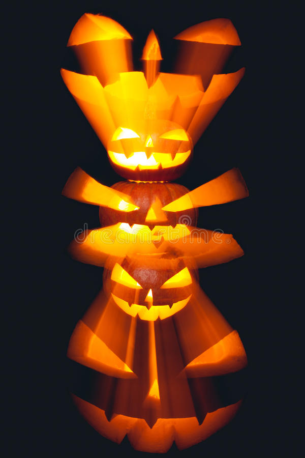 Group of stacked Halloween Jack o Lanterns with black background royalty free stock photography
