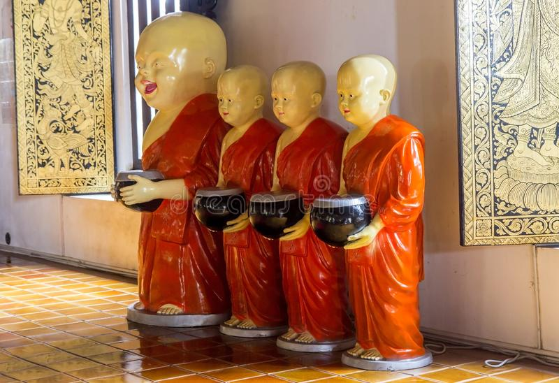 A group of statues of monks in a Buddhist monastery stock photos