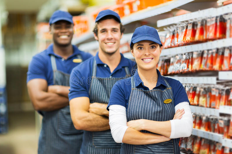 Group store co-workers. Group of smiling hardware store co-workers stock photo