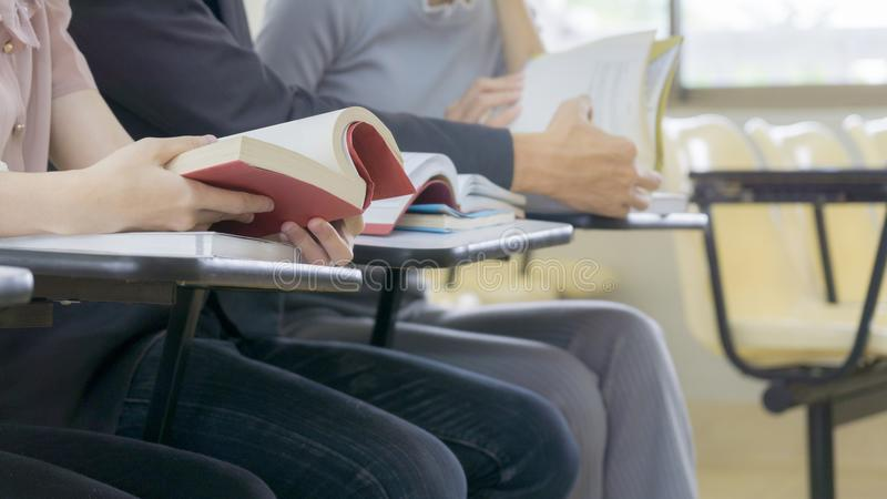 Group student read book and sit in classroom stock photography