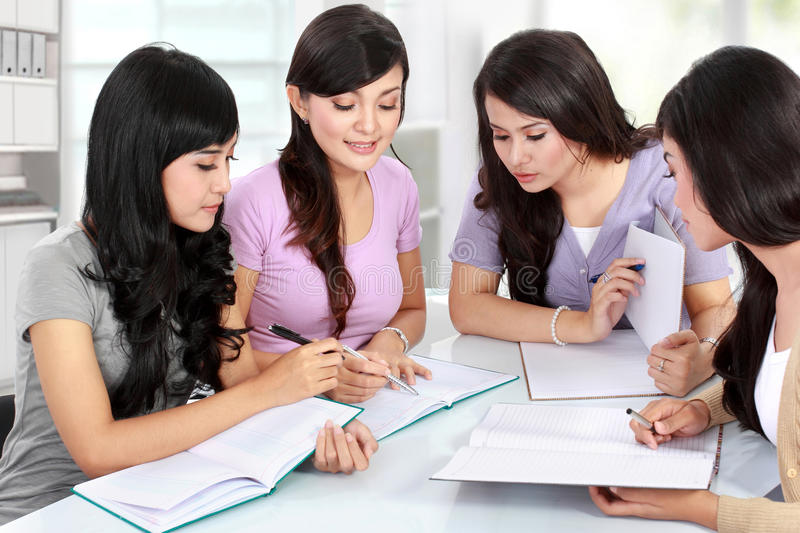 Group of student studying together stock photography