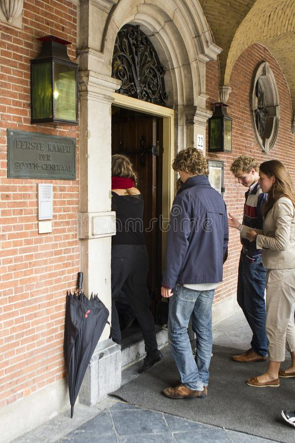 A group of students at the beginning of the study year visit senat dutch parliament umbrella entrance stock photography