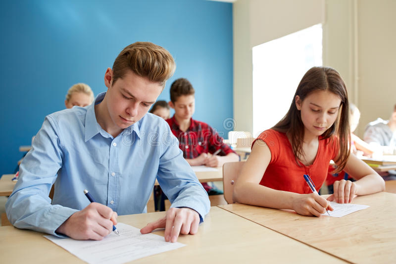 group-students-books-writing-school-test