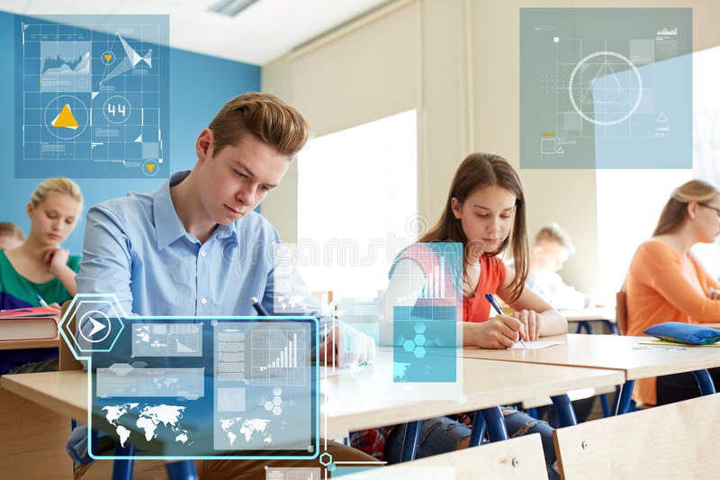 Group of students with books writing school test. Education, statistics and people concept - group of students with books writing school test over virtual stock photos