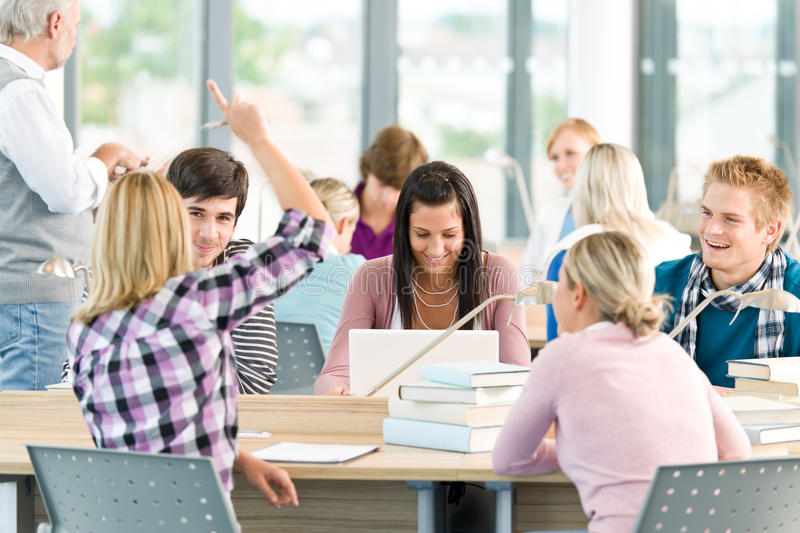Group of students in classroom stock images