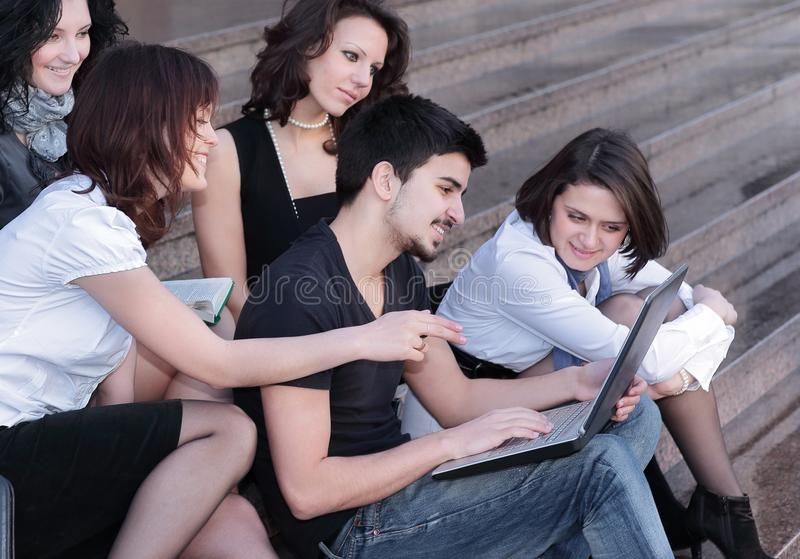 Group of students communicating via the Internet using laptop. Closeup. a group of students communicating via the Internet using laptop stock image