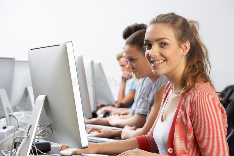 Group Of Students In Computer Class. Smiling stock photo