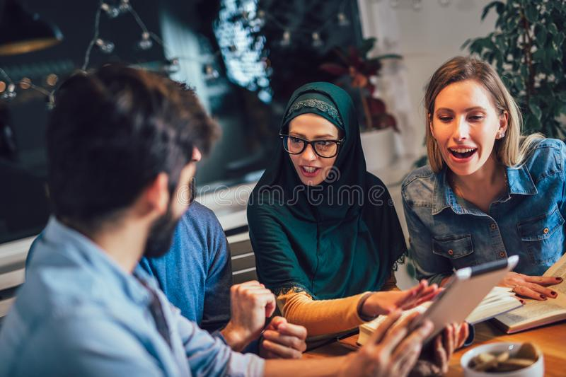 Students of diverse ethnic learning at home. Learning and preparing for university exam, selective focus royalty free stock photo
