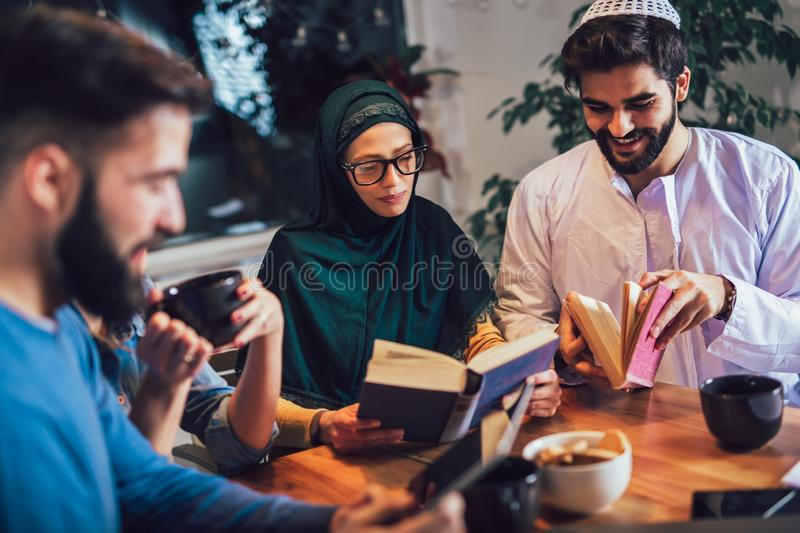 Students of diverse ethnic learning at home. Learning and preparing for university exam, selective focus royalty free stock images