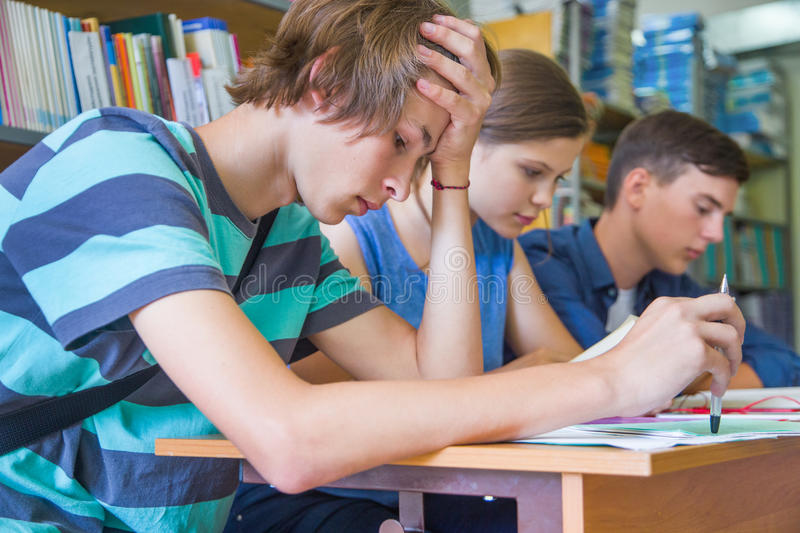 Teens in library royalty free stock photo