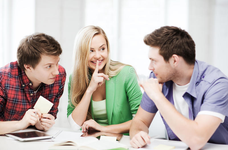 Group of students gossiping at school. Education concept - group of students gossiping at school royalty free stock images