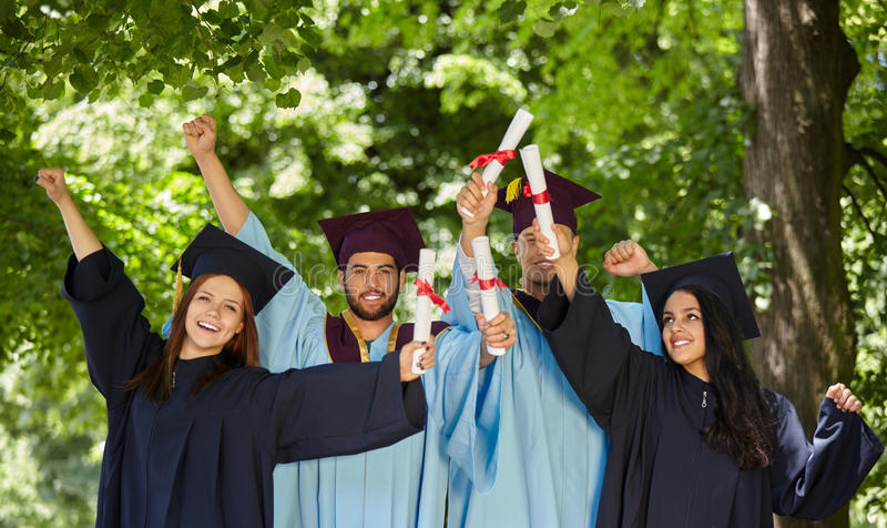 Group of students in graduation gowns royalty free stock photo