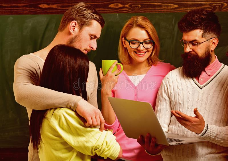 Group of students, groupmates spend time with teacher, lecturer, professor. College and university concept. Students royalty free stock image