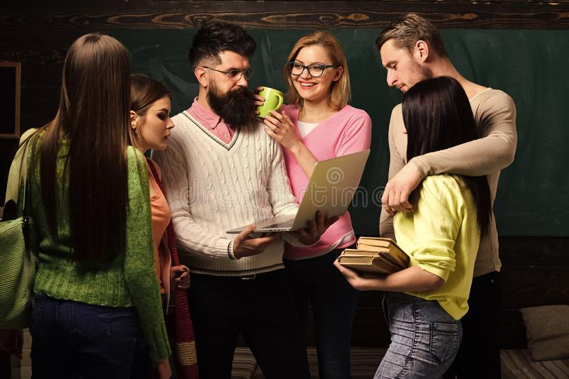 Group of students, groupmates spend time with teacher, lecturer, professor. Students, scientists studying after classes stock photos
