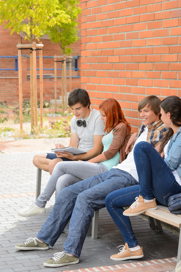 Group of students hanging out by college royalty free stock photography
