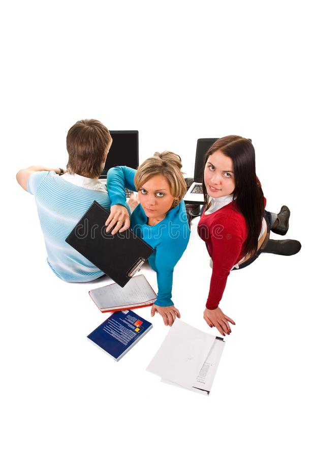 Group of students having fun, doing home work (iso stock image