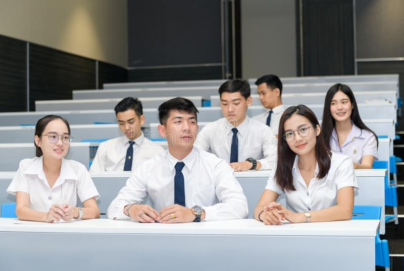 Group of students learning in classroom royalty free stock photography